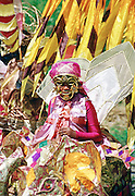 Dancers in ornate colourful national costumes at a carnival in Trinidad.