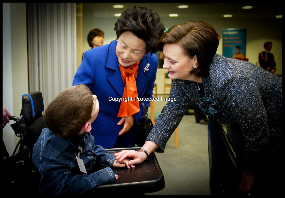 The Prime Ministers Wife Cherie Blair and  Madame Roh Talk to Jack Suslak 12,From Meldreth Manor School,Cambridge  on a visit to  Scope HQ,London, Second day of State visit by the President of South Korea.PA Photo Andrew Parsons Rota