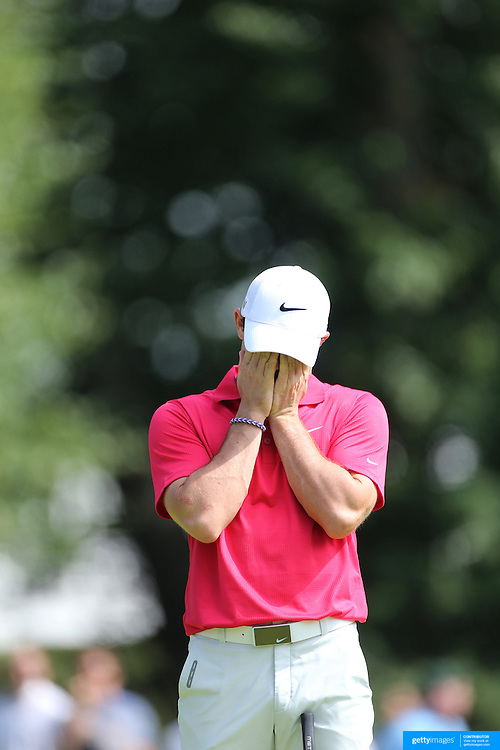 Rory McIlroy reacts after missing an easy putt on the second hole during the first round of theThe Barclays Golf Tournament at The Ridgewood Country Club, Paramus, New Jersey, USA. 21st August 2014. Photo Tim Clayton