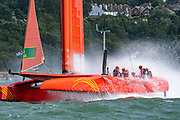 SailGP Team China sailors get a hosing att he top mark in race one. Race Day. Event 4 Season 1 SailGP event in Cowes, Isle of Wight, England, United Kingdom. 11 August 2019: Photo Chris Cameron for SailGP. Handout image supplied by SailGP