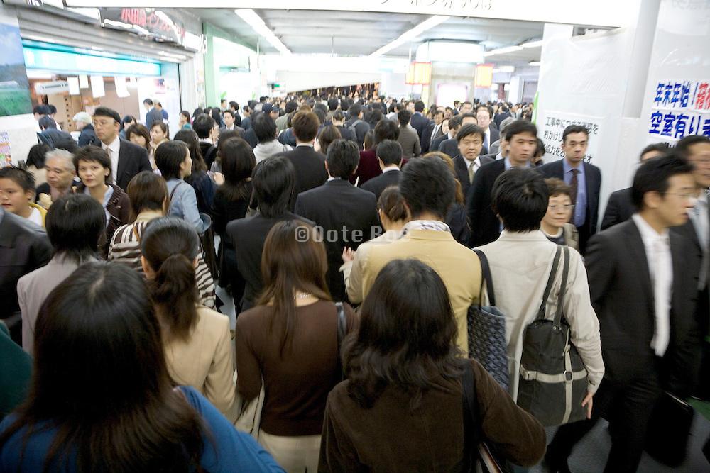 business commuters Shinjuku railway station Japan