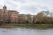 """Hammersmith, Greater London, 15th March 2020, Inaugural Women's Lightweight Boat Race, Oxford University Lightweight Women, [Blue Boat], takes a few feet, over Cambridge University Lightweight Women's BC, as both crews pass, """"Harrods Village"""". William Hunt Mansions, AKA Harrods Depository, on the approach to Hammersmith Bridge, Championship Course, Putney to Mortlake, River Thames, [Mandatory Credit: Peter SPURRIER/Intersport Images],"""