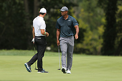 August 9, 2018 - St. Louis, Missouri, United States - Tiger Woods (R) and Rory McIlroy walk the green during the first round of the 100th PGA Championship at Bellerive Country Club. (Credit Image: © Debby Wong via ZUMA Wire)