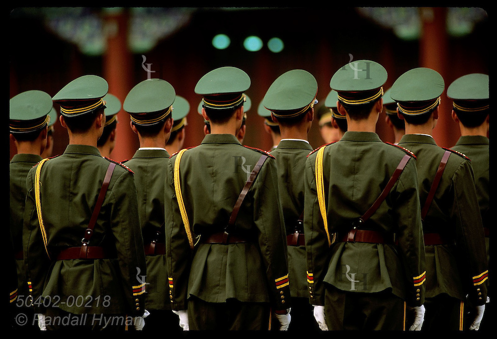 Seen from behind, soldiers stand at attention during inspection outside Forbidden City; Beijing. China