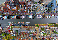 Aerial view above of boats anchored at Amsterdam canal, Netherlands.