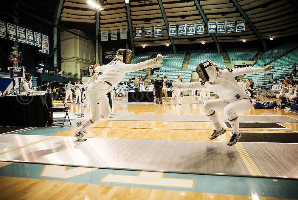Duke University Blue Devil, Tara Mullen-Boustiha, spares against Norte Dame Fighting Irish, Catherine Lee, during the 2015 ACC Fencing Championships, Feb. 22, which was hosted at the University of North Carolina, Chapel Hill, for the first time in the schools history.