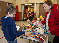 Dean Doeshaj and Leigh Walls do some of Dean's Christmas shopping during Presents for Pleasant  event on Friday evening.  (Karen Bobotas/for the Laconia Daily Sun)