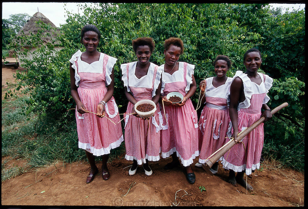 Vendan women with their termite collecting equipment; sticks to penetrate into the termite mounds in order to retrieve the insects and bowls to collect them, Masetoni, Mpumalanga, South Africa. Fried termites are nutty and crunchy. (page 138,139)