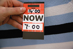 Sale label on clothing in a department store,