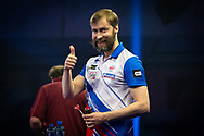 Dmitriy Gorbunov (Russia) smiling in defeat during the William Hill World Darts Championship at Alexandra Palace, London, United Kingdom on 20 December 2020.