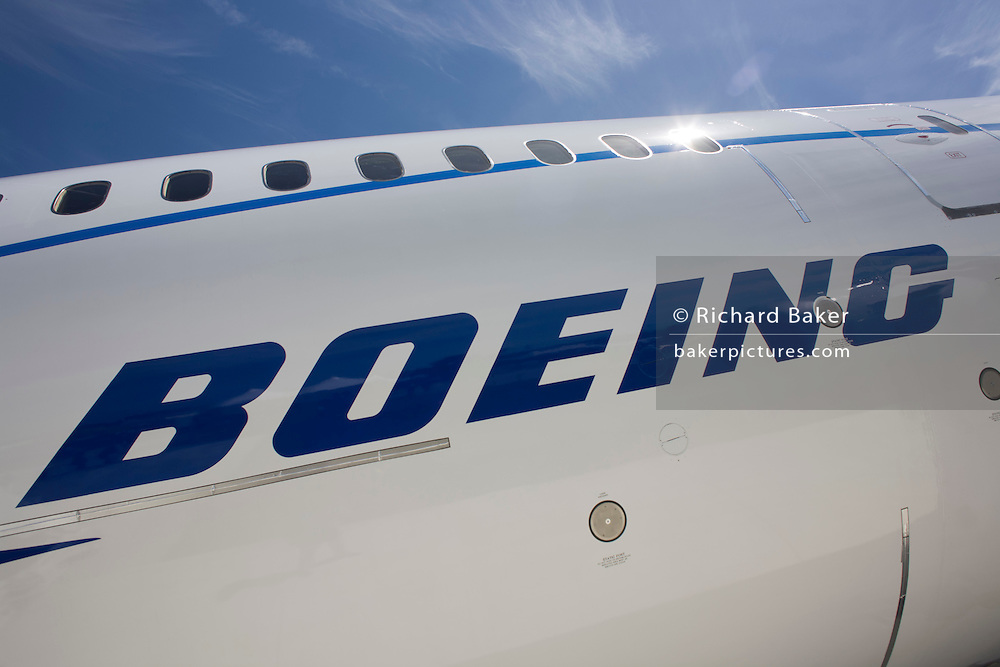 Company logo on side of the Boeing-manufactured 787 Dreamliner (N787BX) at the Farnborough Airshow. On its first flight outside of the US during its testing programme, the newest airliner in the Boeing aviation family, has arrived at the air show for a few days of exhibitions to the aerospace-buying community and the trade press. Later the public will have the chance to see this jet up close too. The Boeing 787 Dreamliner is a long range, mid-sized, wide-body, twin-engine  jet airliner developed by Boeing Commercial Airplanes. It seats 210 to 330 passengers, depending on variant. Boeing states that it is the company's most fuel-efficient airliner and the world's first major airliner to use composite materials for most of its construction