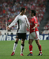 Photo: Lee Earle.<br /> Benfica v Manchester United. UEFA Champions League, Group F. 26/09/2006. United's Cristiano Ronaldo (L) squares up to Karagounis.