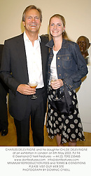 CHARLES DELEVINGNE and his daughter CHLOE DELEVINGNE at an exhibition in London on 6th May 2003.PJI 94