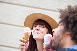 Close-up of couple eating ice cream