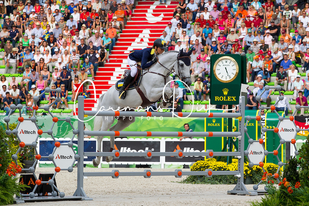 Katharina Offel, (UKR), Charlie - World Champions, - Second Round Team Competition - Alltech FEI World Equestrian Games™ 2014 - Normandy, France.<br /> © Hippo Foto Team - Leanjo De Koster<br /> 25/06/14