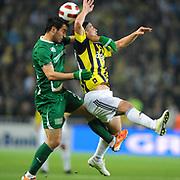 Fenerbahce's Mehmet TOPUZ (R) during their Turkish superleague soccer match Fenerbahce between Bursaspor at the Sukru Saracaoglu stadium in Istanbul Turkey on Sunday 03 April 2011. Photo by TURKPIX