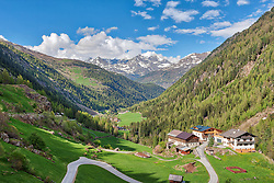 Scenic view of town and green mountain landscape, Heiligkreuz, Otztal, Austria