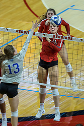 BLOOMINGTON, IL - October 23: Nicole Lund places a hit out of reach of Ashlynn Kuhn during a college Women's volleyball match between the ISU Redbirds and the Drake Buldogs on October 23 2021 at Illinois State University in Normal, IL. (Photo by Alan Look)