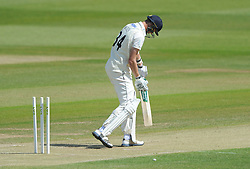 Craig Miles of Gloucestershire cuts a dejected figure after being bowled out by Kyle Jarvis of Lancashire for 12 in the second over - Photo mandatory by-line: Dougie Allward/JMP - Mobile: 07966 386802 - 08/06/2015 - SPORT - Football - Bristol - County Ground - Gloucestershire Cricket v Lancashire Cricket Day 2 - LV= County Championship