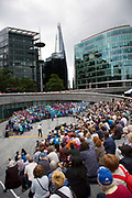 Adults choir, made from choirs from all over the region, perform to a gathered audience at The Scoop. Totally Thames takes place over the whole month in September, combining arts, cultural and river events presented by Thames Festival Trust throughout the 42-mile stretch of the River Thames in London, UK.