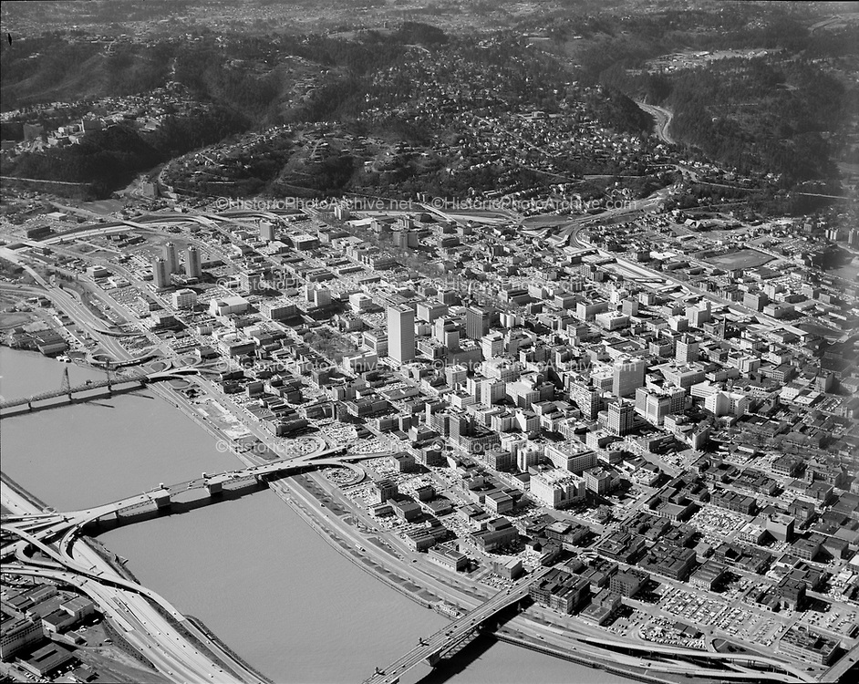 """Ackroyd 16605-10. """"City of Portland. Aerials. February 20, 1970"""" (Downtown Portand & Willamette River looking south-west.)"""