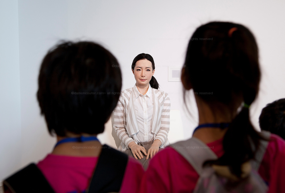 Otonaroid lifelike robot speaks to young visitors at Miraiken Science Museum, Odaiba, Tokyo. Japan. Friday June 27th 2014. Created by Osaka robotics professor, Hiroshi Ishiguro the remotely-controlled android tests people interact with androids.