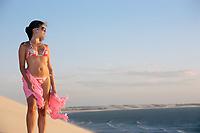 beautiful  bikini dressed with a saron young brazilian  woman in jericoacoara at the sunset ceara state near fortaleza