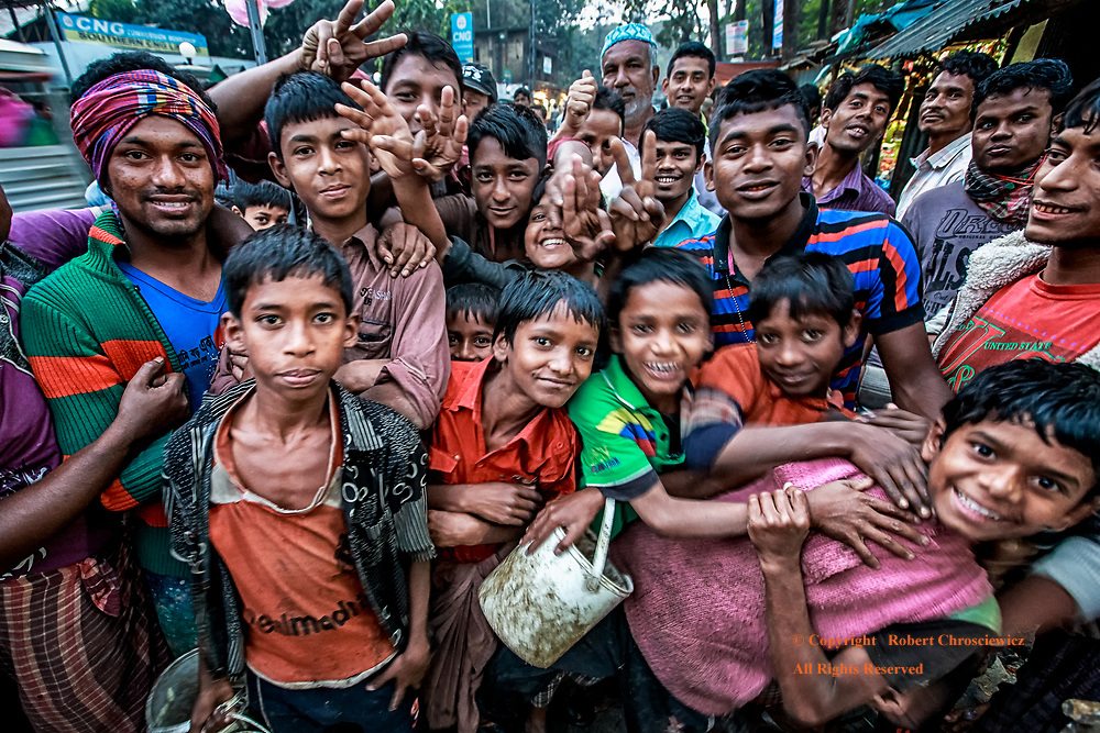 Market Madness: A most enthusiastic all male crowd gleefully struggles to get into the photograph, Dhaka Bangladesh.