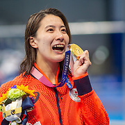 TOKYO, JAPAN - JULY 25   Yui Ohashi of Japan poses for photographs with her gold medal after winning the 400m Individual Medley for Women during the Swimming Finals at the Tokyo Aquatic Centre at the Tokyo 2020 Summer Olympic Games on July 25, 2021 in Tokyo, Japan. (Photo by Tim Clayton/Corbis via Getty Images)