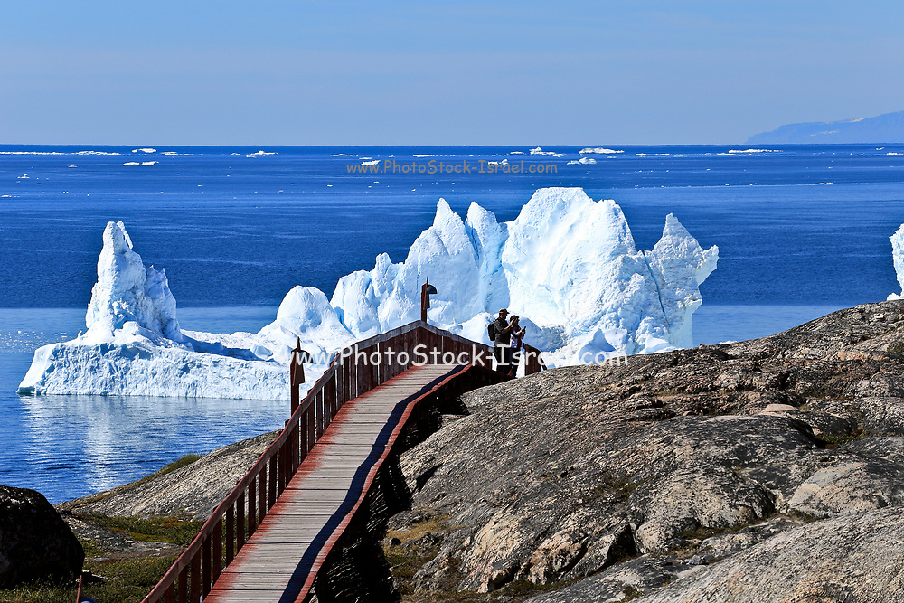 Icebergs float in the water near the town Ilulissat formerly Jakobshavn or Jacobshaven, Western Greenland