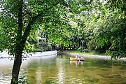 Lake and boat in Cismigiu park Bucharest, Romania