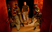 Marine, Steven Jacobs, teaches Djiboutian policeman how to move through hallways as a team on Nov. 16, 2005..Djiboutian police train in counter terrorism messures with the US Marine Corps off the Horn of Africa.
