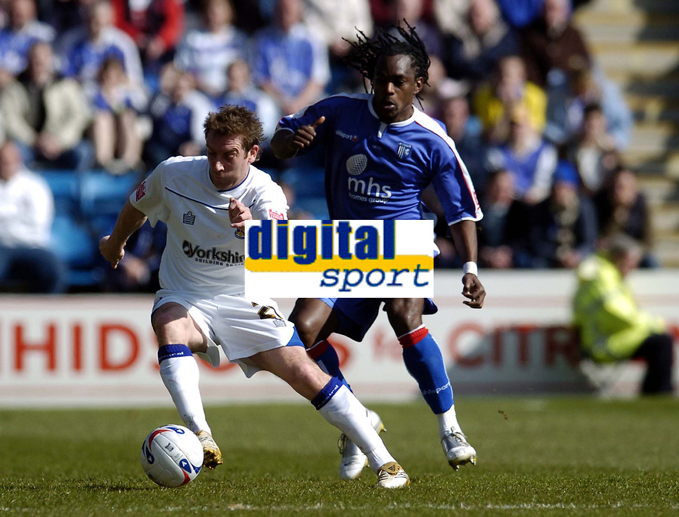 Photo: Olly Greenwood.<br />Gillingham v Huddersfield Town. Coca Cola League 1. 08/04/2006. Huddersfield's Andy Booth and Gillingham's Brent Sancho battle.