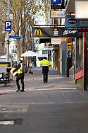 High Vis workers are the most obvious signs of life on the streets of the Melbourne CBD as the state waits to see if the lockdown will be extended as it enters 6th day of the state wide COVID-19 snap lockdown that has been placed on the State of Victoria.  (Photo by Michael Currie/Speed Media)