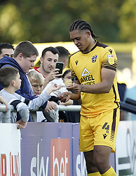 Sutton United's Coby Rowe celebrates with fans after the Sky Bet League Two match at Borough Sports Ground, Sutton. Picture date: Saturday October 9, 2021.
