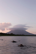 Landscape with view of the Concepcion volcano and Lake Nicaragua under a moody sky at sunset, Ometepe Island, Nicaragua