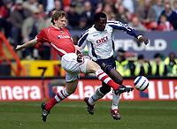 Photo: Olly Greenwood.<br />Charlton Athletic v Portsmouth. The Barclays Premiership. 17/04/2006. Charltons Jonathan Spector and Portsmouths Benjani Mwaruwari