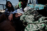 Juana Jara, 52, who was hospitalized days before the earthquake sits outside the hospital after it was evacuated for security reasons because the building was severly damaged after the earthquake, Talca, Chile Feb 28, 2010.