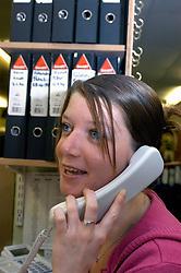 Housing Officer on the telephone in office; Bradford; UK
