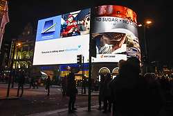© Licensed to London News Pictures. 23/11/2018. LONDON, UK. The giant advertising screen in Piccadilly Circus includes a message from social media company Twitter promoting its service and Black Friday.   Traditional retailers face increasing challenges to attract customers against their online competition.  Photo credit: Stephen Chung/LNP
