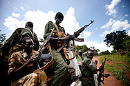 South Sudan soilders with the SPLA cock their guns before traveling through and area where the LRA had recently attacked.