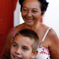 Central America, Cuba, Remedios. Cuban boy and mother in Rememdios.