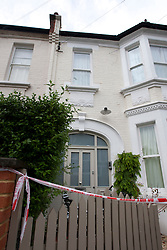 © licensed to London News Pictures. London, UK 10/05/2012. The house where a 10-week-old boy and his 14-month-old sister were found dead by police in Killarney Road, Wandsworth, south-west London. Photo credit: Tolga Akmen/LNP