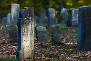 Weathered cemetery headstones, afternoon light, October, Hillsborough County, Hancock, New Hamphshire, USA