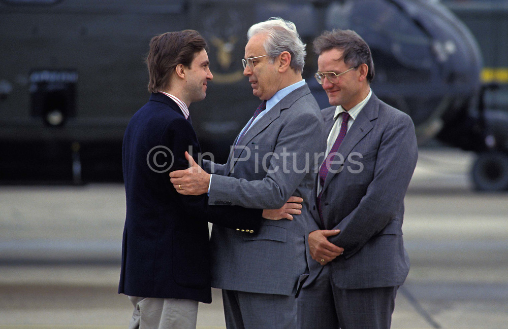 Released Beirut hostage, journalist John McCarthy left is greeted by United Nations Secretary-General Perez de Cuellar centre and Douglas Hogg MP from the British Foreign Office right at RAF Lyneham after being held prisoner for 5 years by Jihadists in Lebanon, on 11th August 1991, in Lyneham, England. McCarthy was the United Kingdoms longest-held hostage in Lebanon where he was a prisoner from April 1986, famously forging a strong bond with Irish educator Brian Keenan.