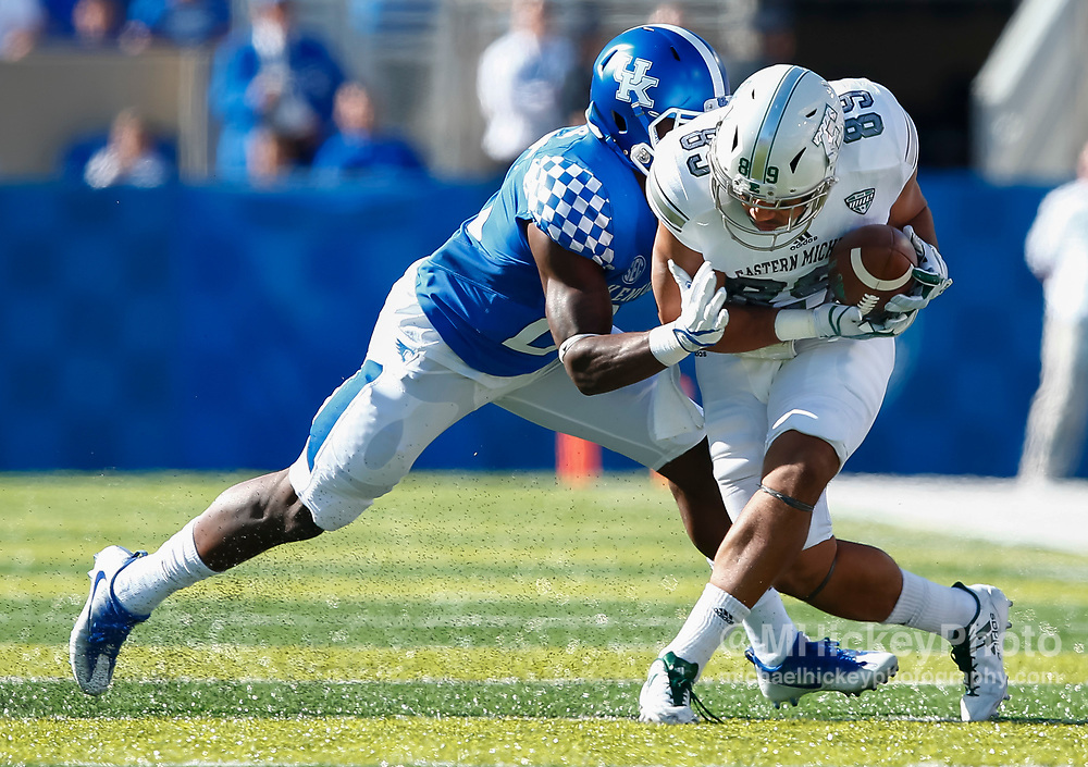 LEXINGTON, KY - SEPTEMBER 30: Darius West #25 of the Kentucky Wildcats makes the stop as John Niupalau #89 of the Eastern Michigan Eagle runs the ball after a reception at Commonwealth Stadium on September 30, 2017 in Lexington, Kentucky. (Photo by Michael Hickey/Getty Images) *** Local Caption *** Darius West; John Niupalau