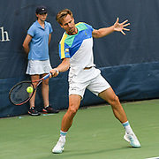 PETER GOJOWCZYK  hits a forehand at the Rock Creek Tennis Center.