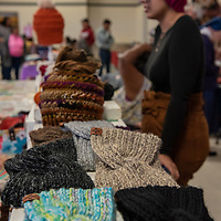 Helping people prepare for winter were handmade hats, gloves and move at Destiny's Crochet Creations table at the annual Recycled Crafts Fair on November 2, 2019 in Gallup.