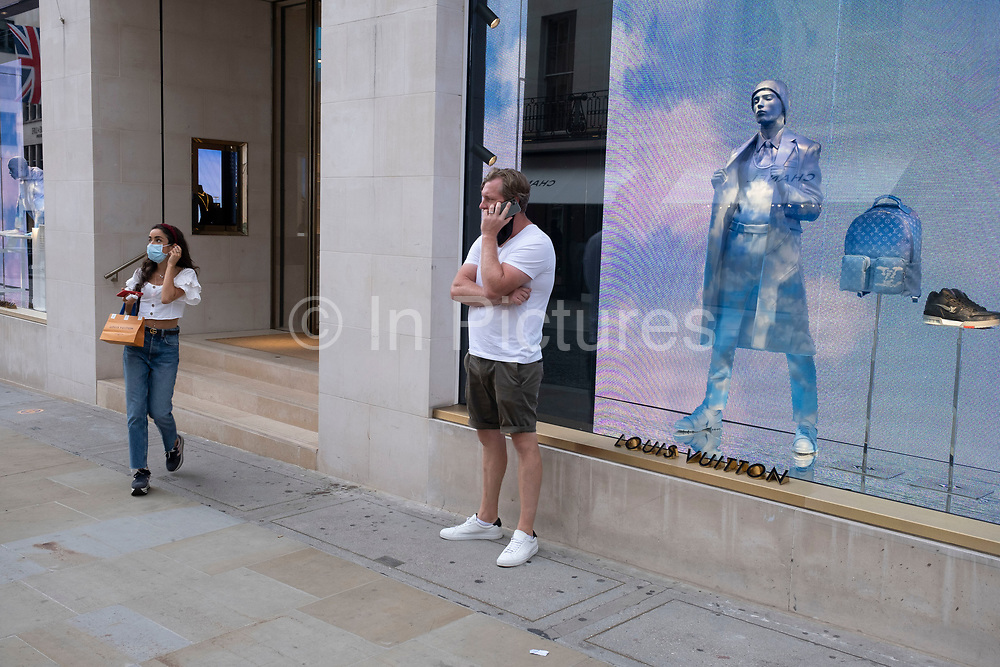 As Britain enters a period of deep recession, as the economic downturn caused by the Covid-19 pandemic cuts, shoppers wearing face masks continue to come to the West End to the exclusive high end fashion shops on Bond Street on 13th August 2020 in London, United Kingdom. The Office for National Statistics / ONS has announced that gross domestic product / GDP, the widest gauge of economic health, fell by 20.4% in the second quarter of the year, compared with the previous quarter. This is the biggest decline since records began. The result is that Britain has officially entered recession, as the UK economy shrank more than any other major economy during the coronavirus outbreak.