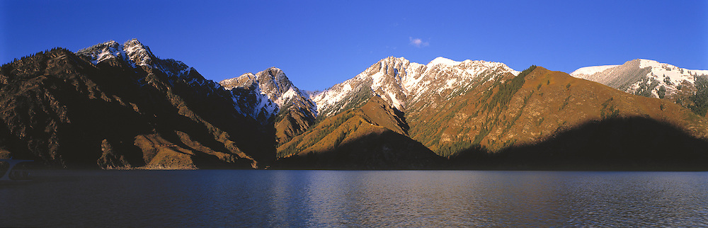 Heavenly Lake is a jewel nestled in the Tien Shan Range, Xinjiang, China. ©Ric Ergenbright